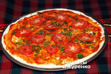 Розкласти скибочки помідора