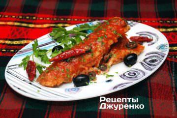 Фото до рецепту: риба з оливками тушкована