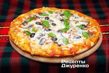 Пицца с сардинами выпекается до 20мин