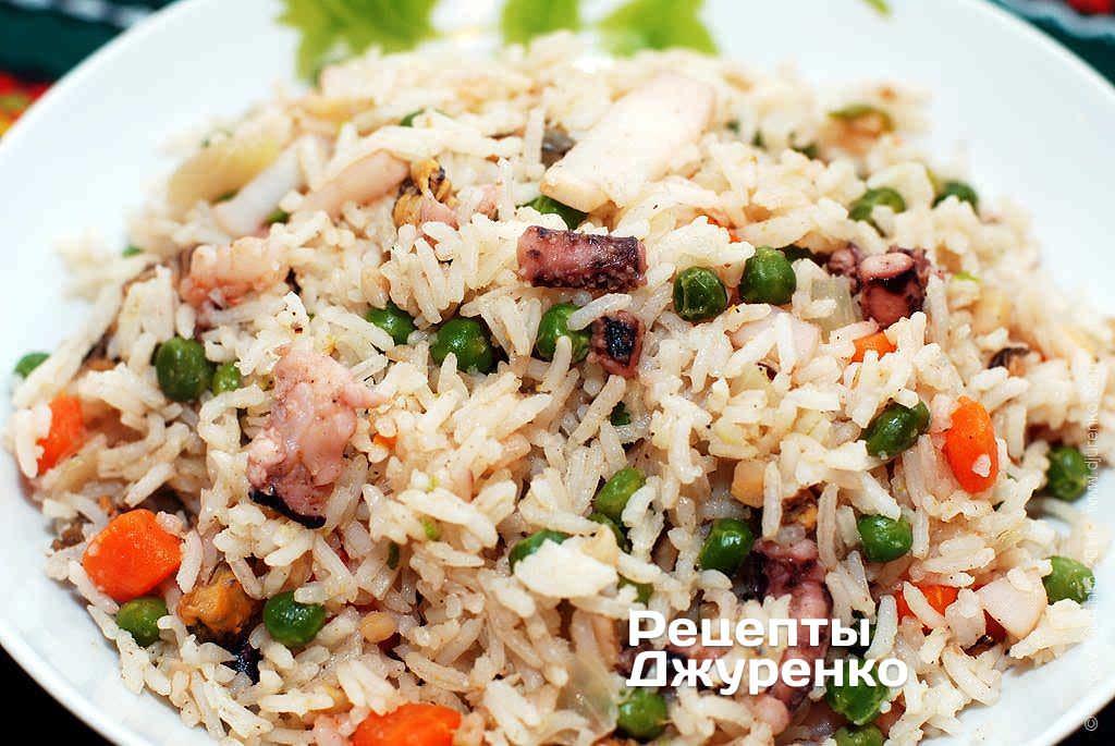 Фото готового рецепта морепродукты с рисом в домашних условиях