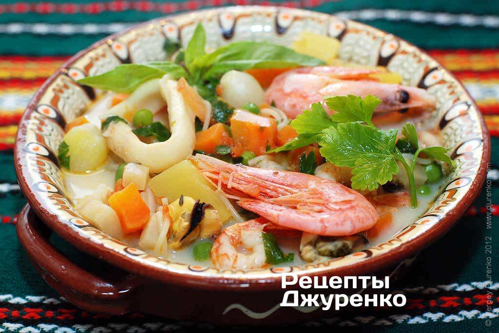 Фото готового рецепту суп з морепродуктів в домашніх умовах