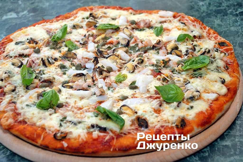 Фото готового рецепта пицца с морепродуктами в домашних условиях