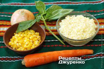 ИІнгредієнти: савойська капуста, морепродукти, рис, кукурудза, базилік, цибуля, морква, вершкове масло, лимон, сухе біле вино, спеції, борошно