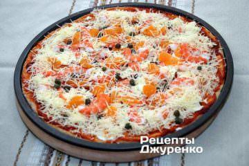 Поставить пиццу в разогретую до 200 градусов духовку