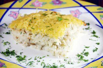 Фото до рецепту: рисова запіканка з філе судака