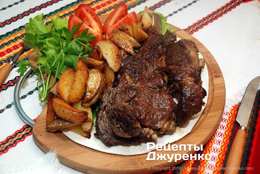 Фото готового рецепта антрекот из говядины в домашних условиях