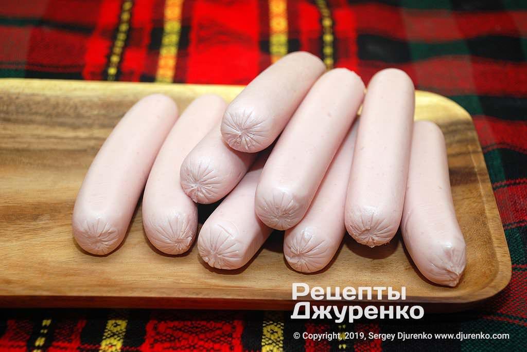 Молочні сосиски.