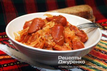 Фото рецепта тушеная капуста с сосисками